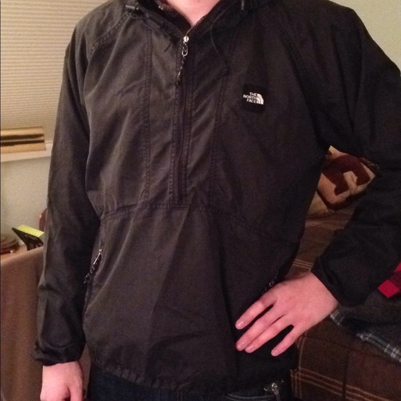 03d823574 The North Face half zip windbreaker with a hood.